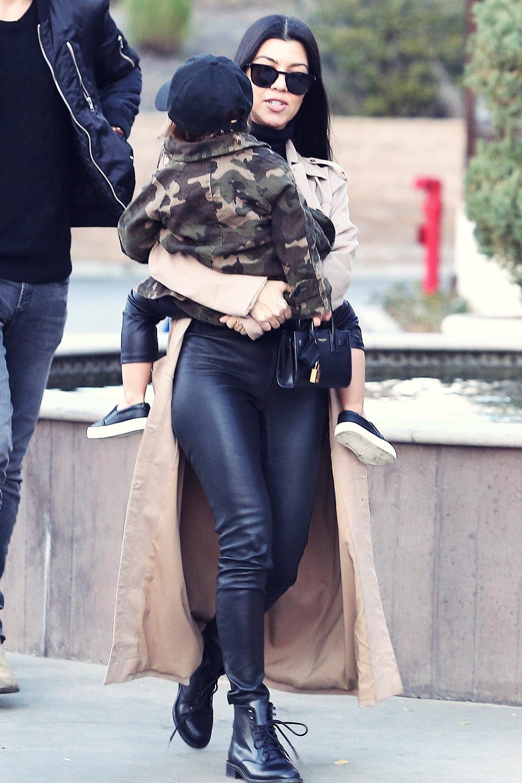Kourtney Kardashian at a movie theater with her family