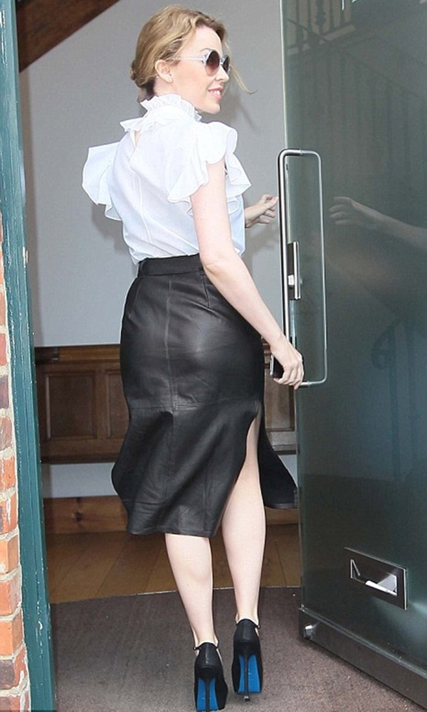 Kylie Minogue in a leather skirt