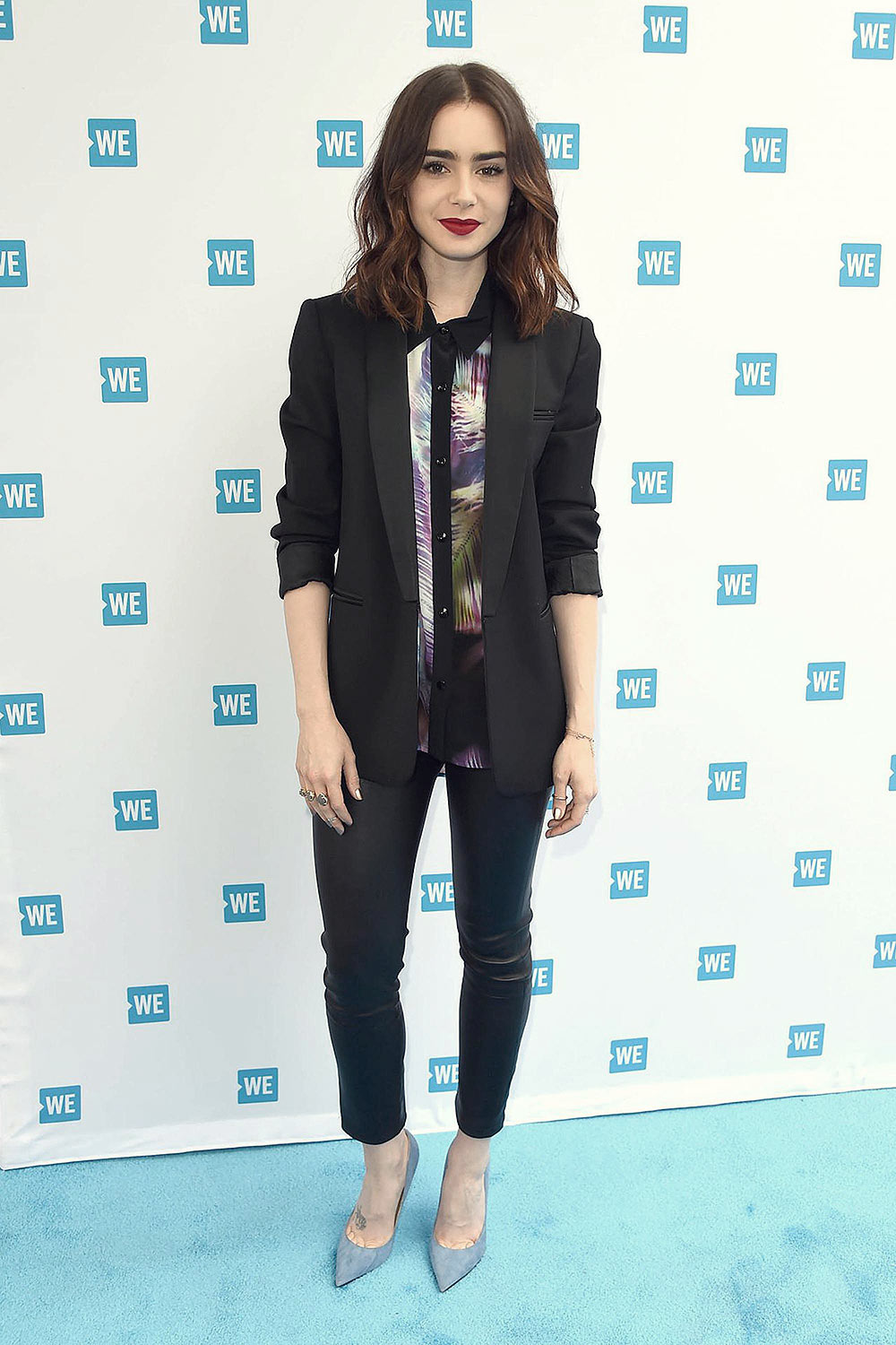 Lily Collins attends WE Day Cocktail Party