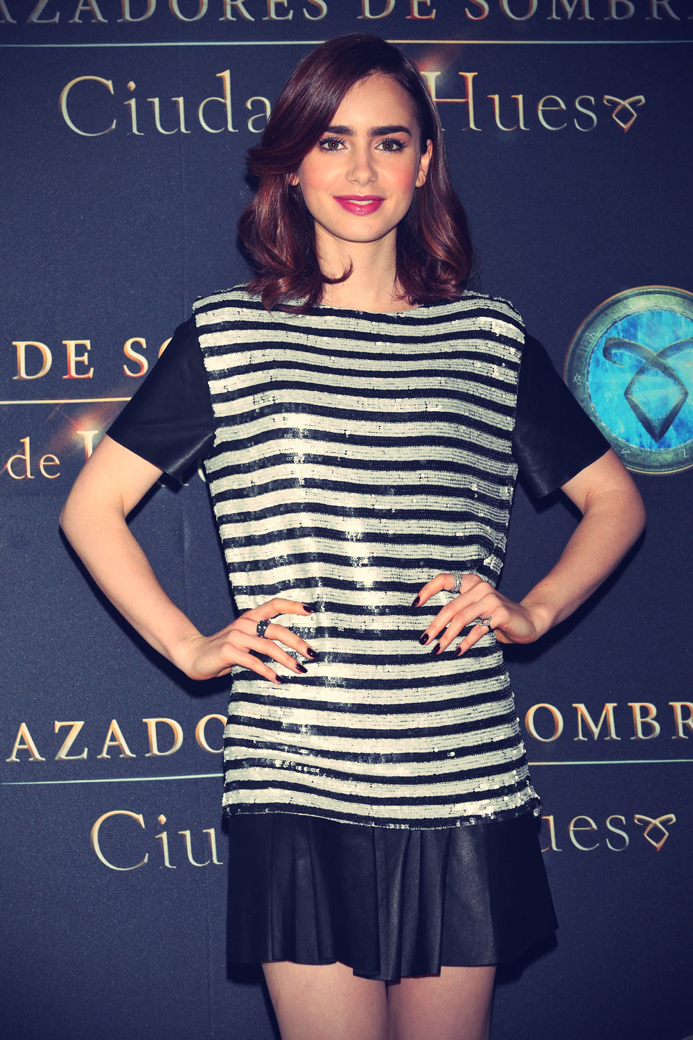 Lily Collins poses for The Mortal Instruments: City of Bones Mexico City photocall