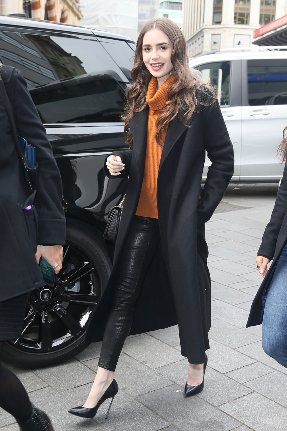 Lily Collins seen arriving at Global studios for radio interviews in London, 04/29/2019