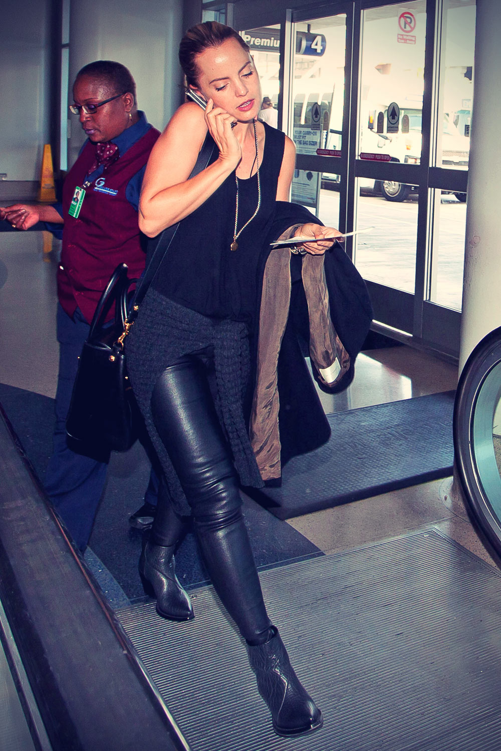 Mena Suvari at LAX Airport as she gets ready to catch a flight