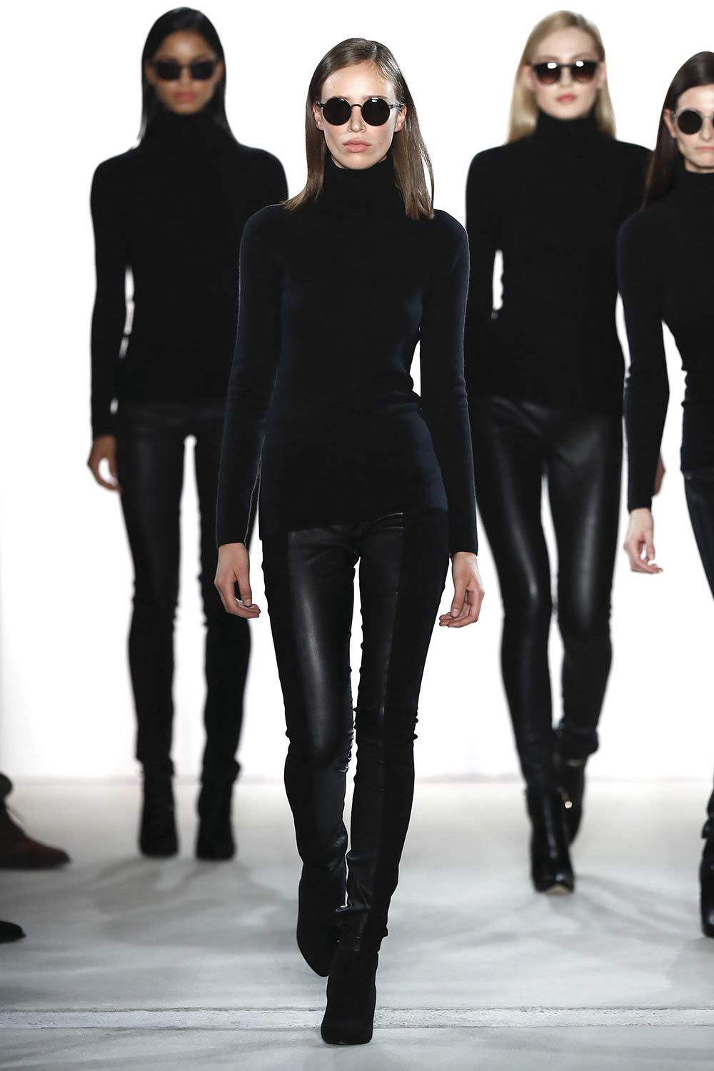 Models walk the runway at the Maisonnoee show