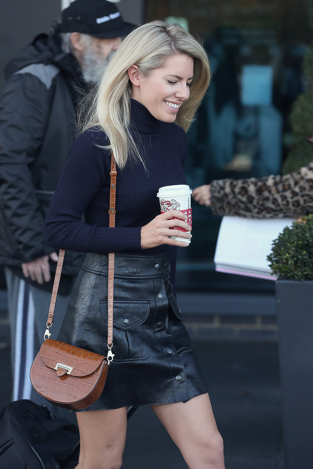 Mollie King seen leaving her hotel with a coffee