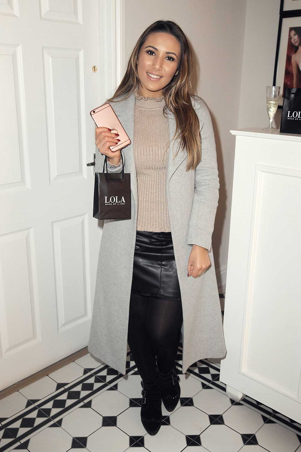 Mona Eyes attends Lola By Perse Boutique Launch