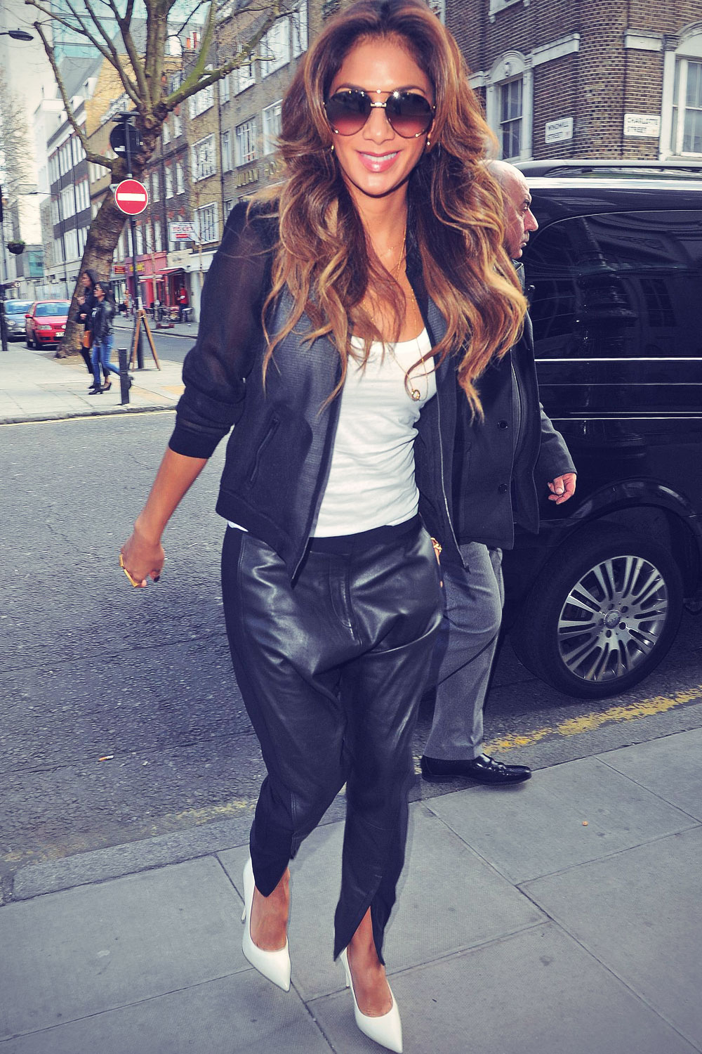 Nicole Scherzinger arrives at an office building