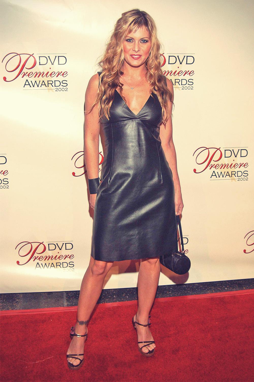 Nicole Eggert in Leather Dress