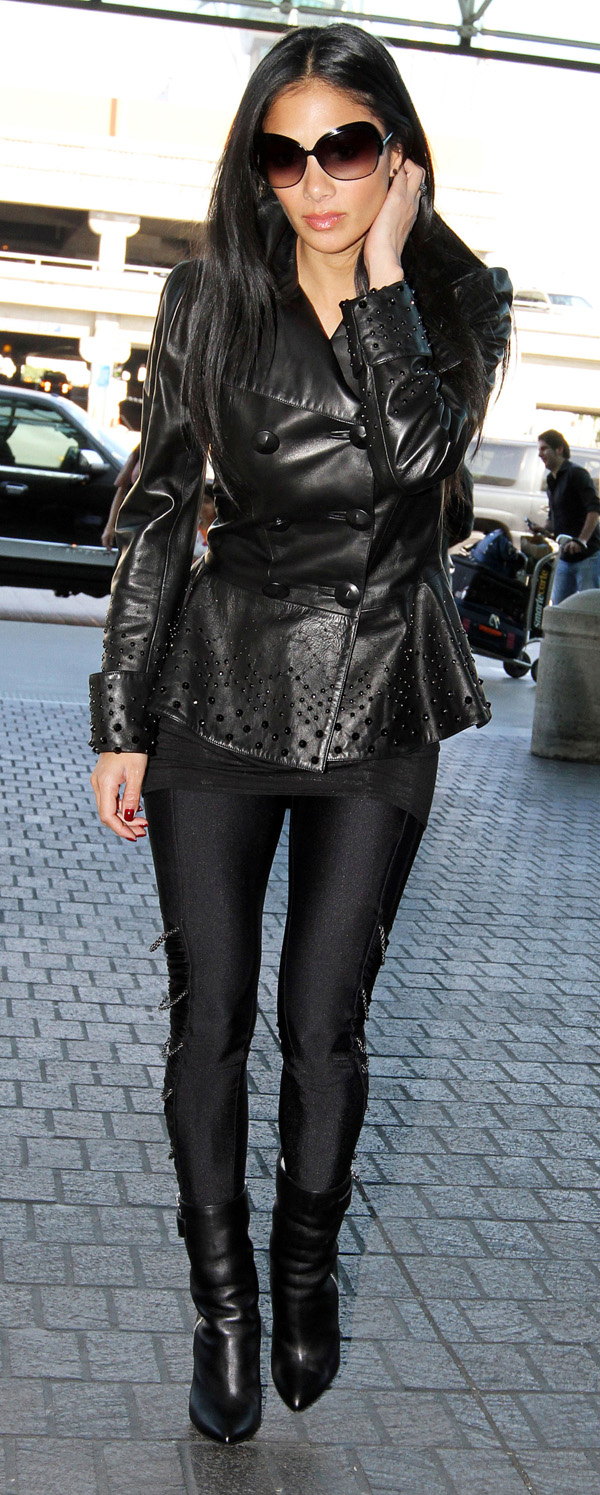 Nicole Scherzinger at LAX Airport and arrive at Heathrow Airport London