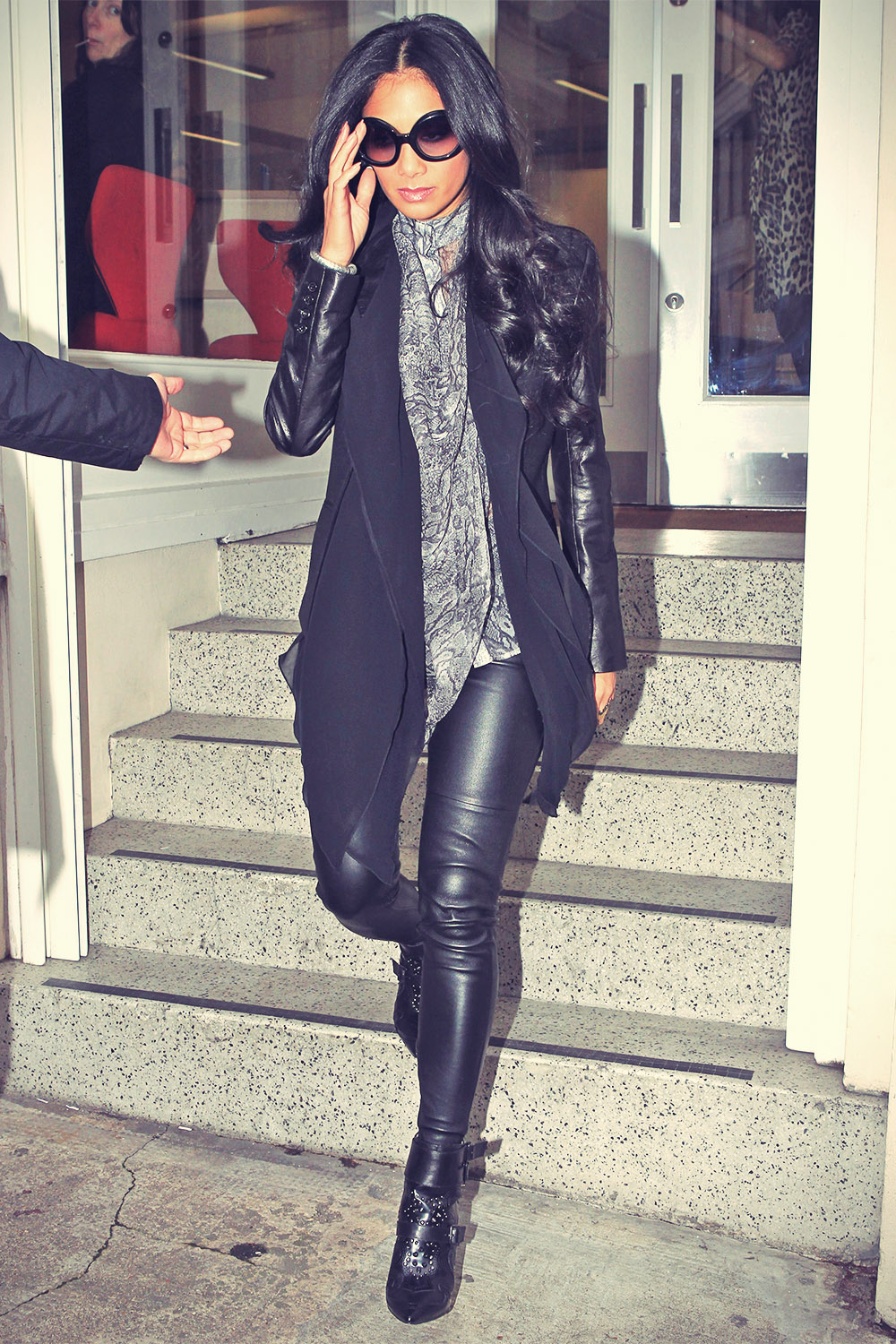 Nicole Scherzinger leaving an office
