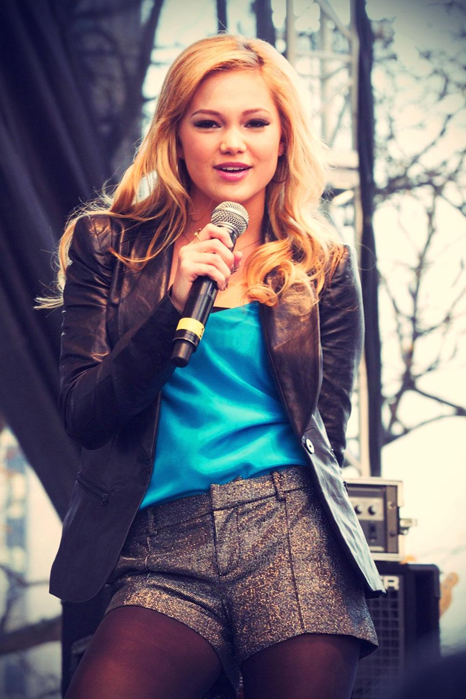 Olivia Holt performing live on stage