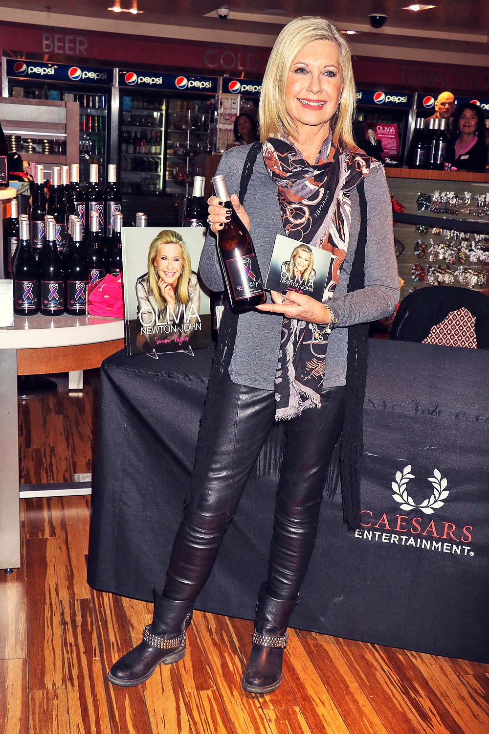 Olivia Newton John Signs Bottles And Cds Leather Celebrities