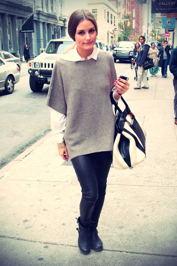 Olivia Palermo sports leather trousers and an oversized sweater
