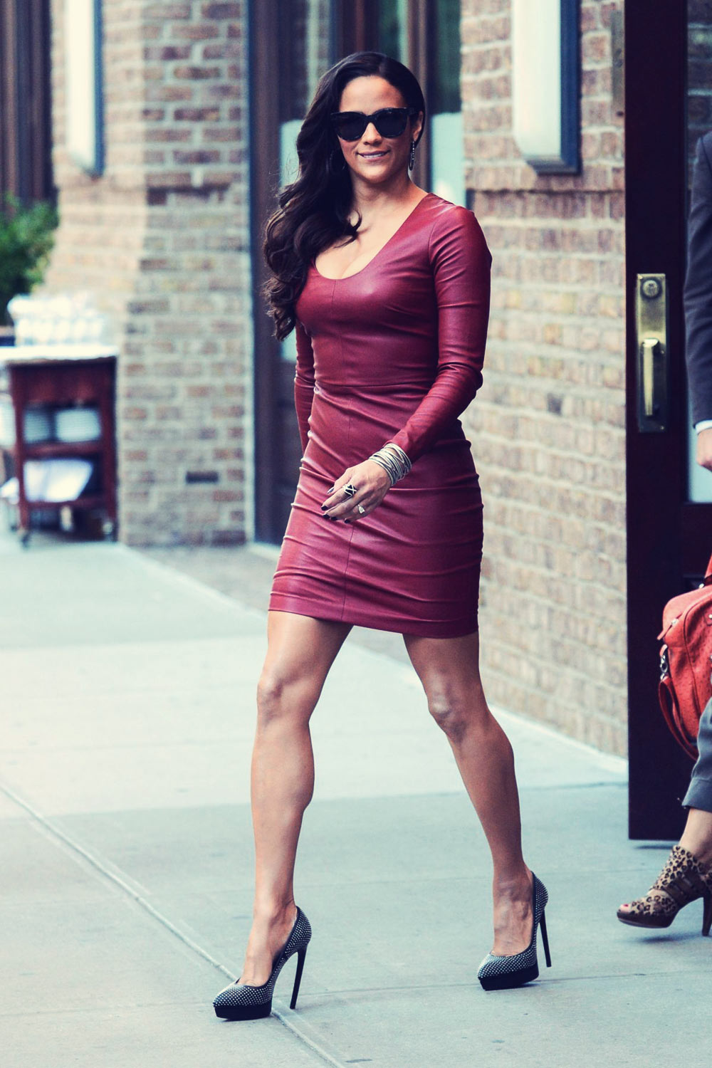 Paula Patton wears a sexy red leather dress while leaving her hotel