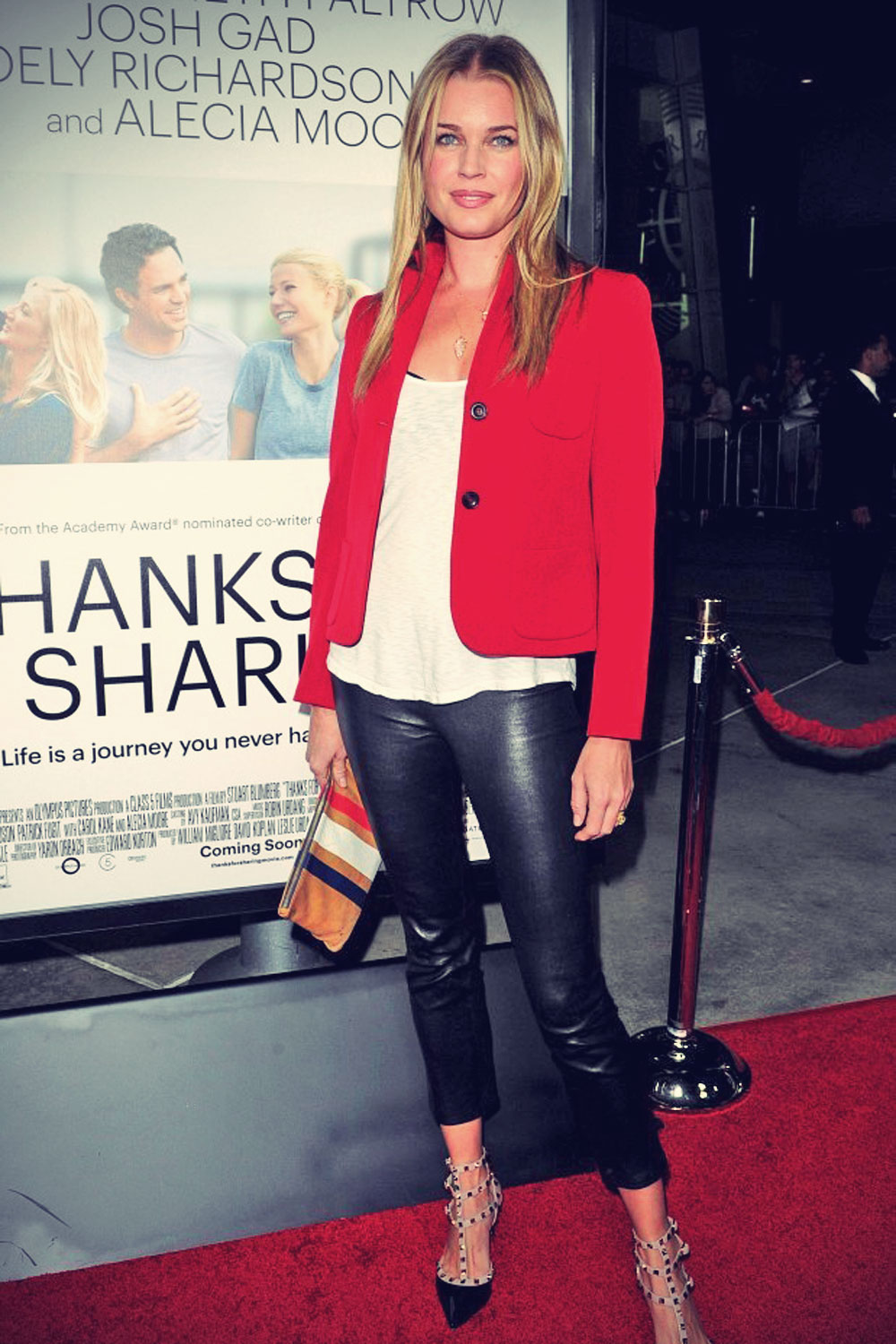 Rebecca Romijn attends the Thanks for Sharing premiere