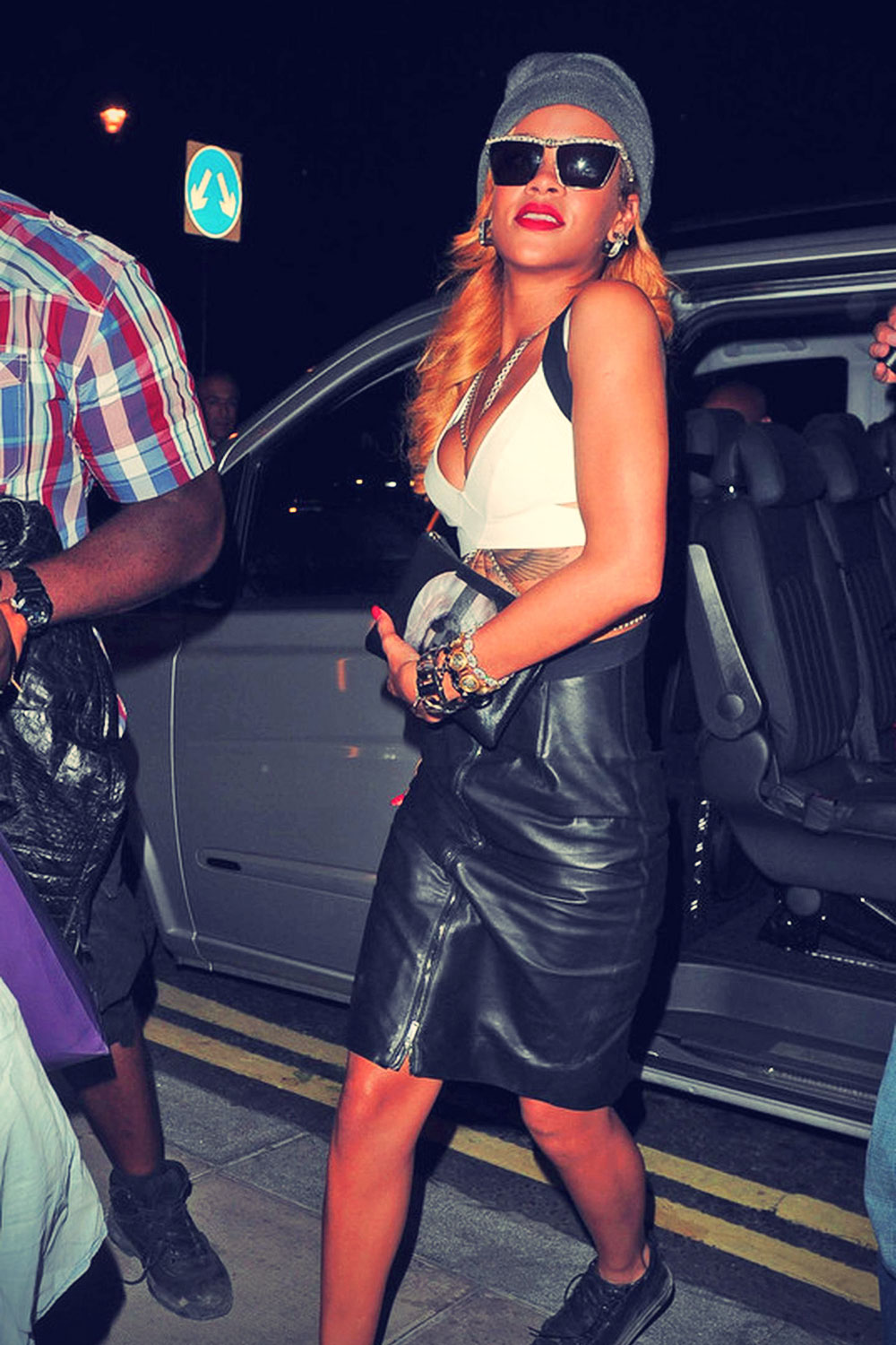 Rihanna shows some midriff as she heads out of her hotel