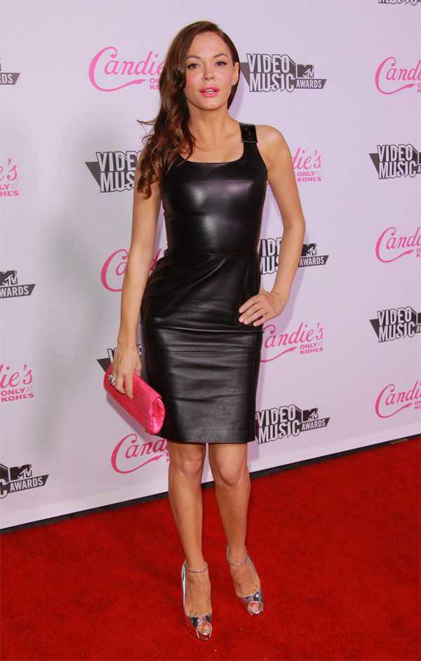 Rose McGowan wearing a black Leather Dress
