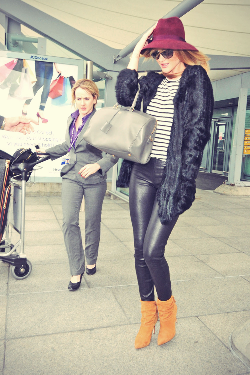 Rosie Huntington-Whiteley arriving at Heathrow Airport on a flight from LA