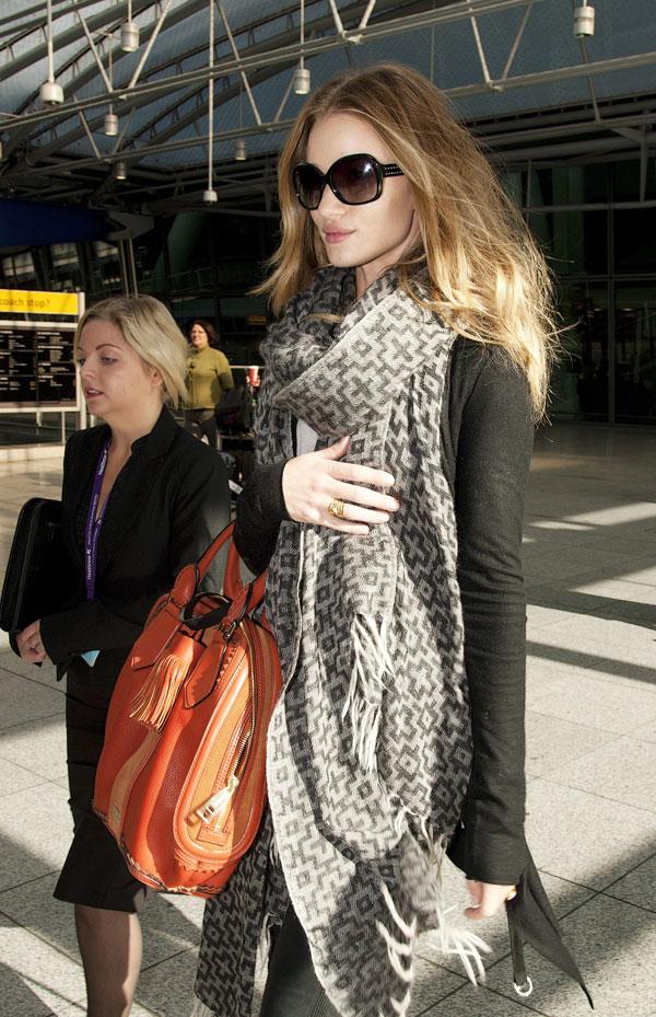 Rosie Huntington-Whitely arriving at London's Heathrow Airport