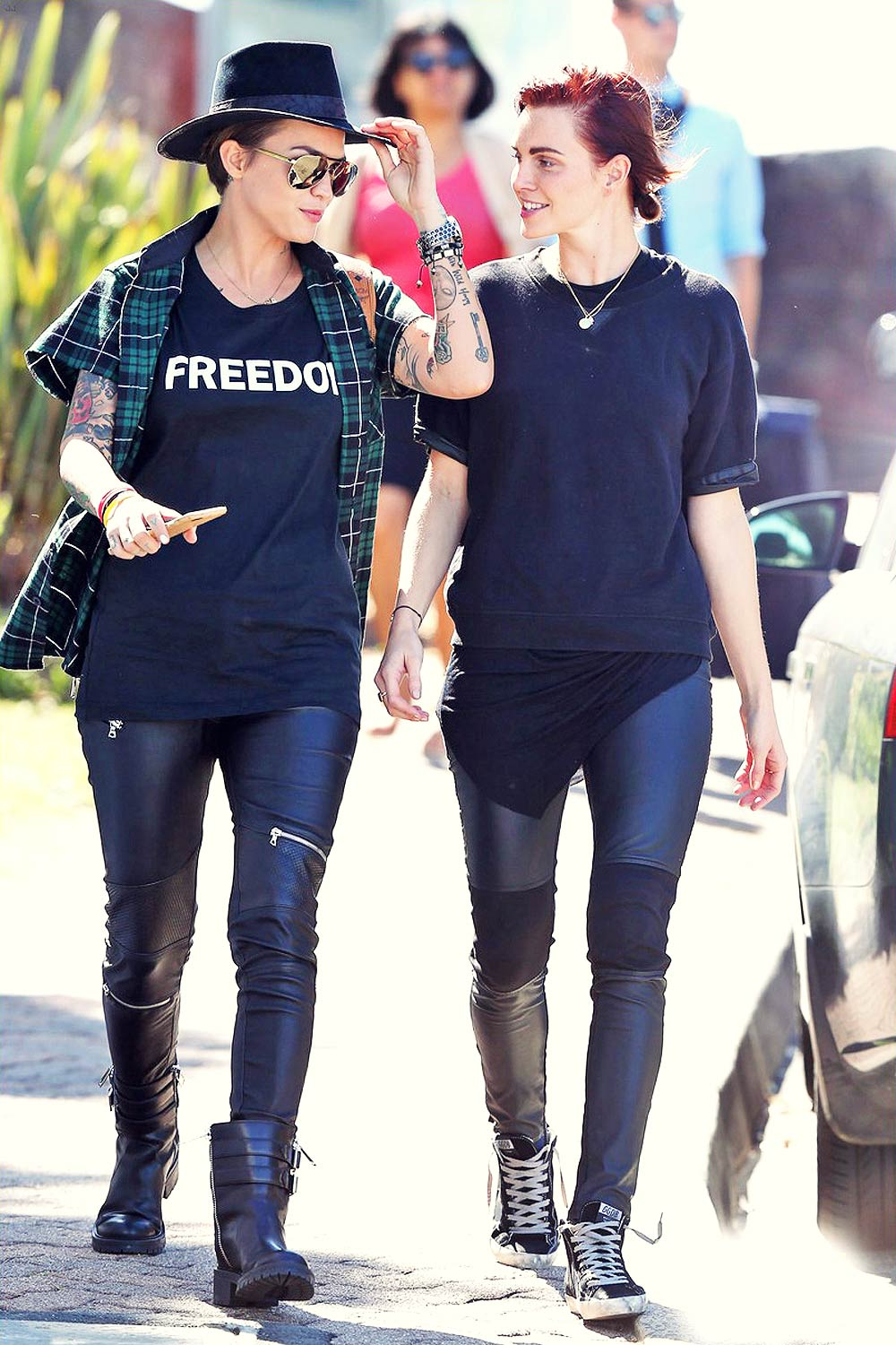 Ruby Rose and her fiancee Phoebe Dahl hold hands