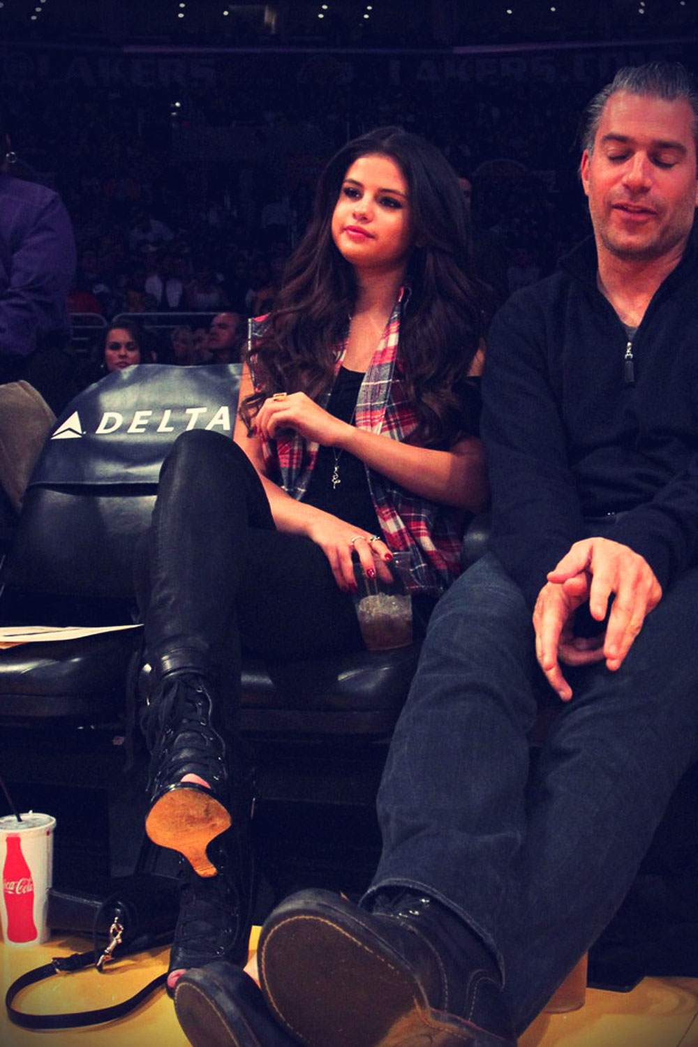 Selena Gomez sits courtside while watching the Los Angeles Lakers