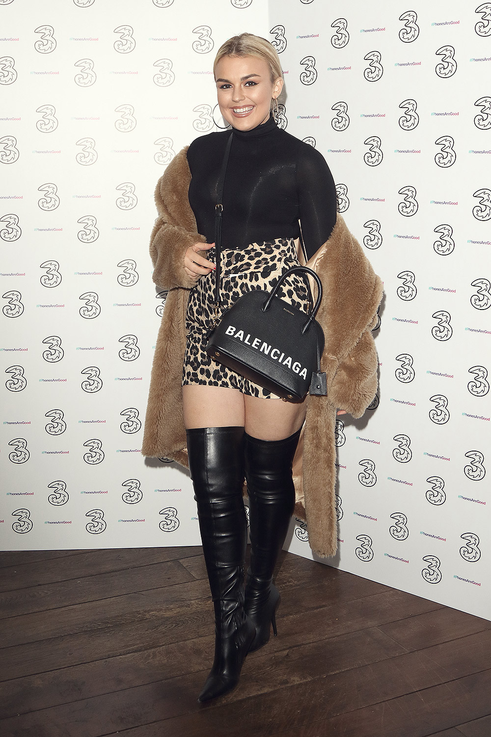 Tallia Storm attends Portr8's Three Mobiles VIP Gallery Launch