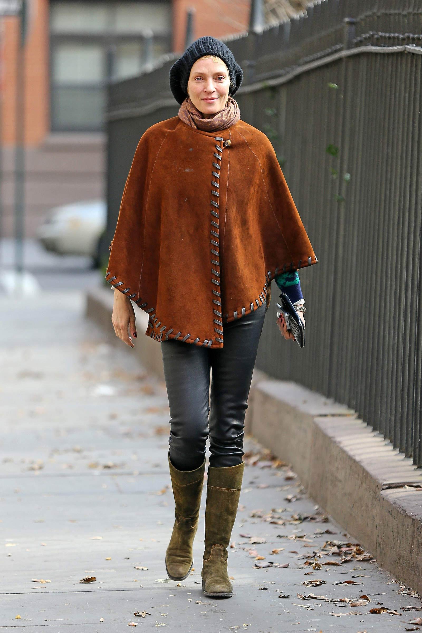 Uma Thurman walking around in New York City