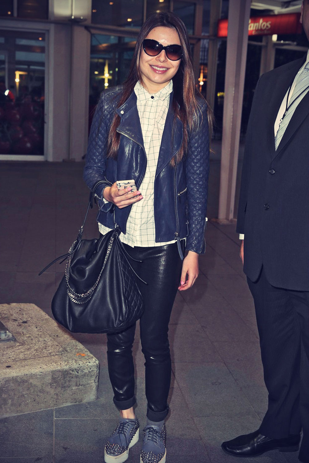 Miranda Cosgrove is all smiles as she makes her way through the airport